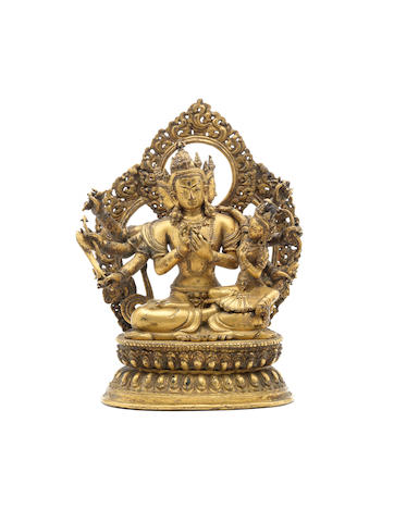 A gilt-bronze figure of a Buddhist deity and mandorla 17th/18th century