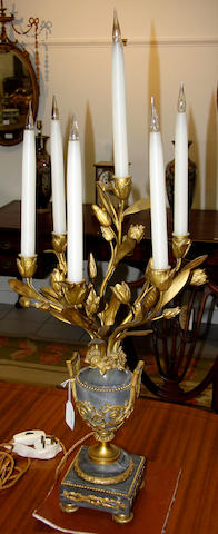 A pair of Louis XVI style gilt metal and grey marble candelabrum, later wired for electricity, the twin handled vase shape bases on square plinths, the flowering branches of six lights,96cm.
