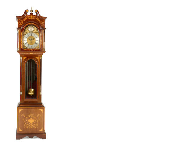 An early 20th century inlaid mahogany quarter chiming longcase clock