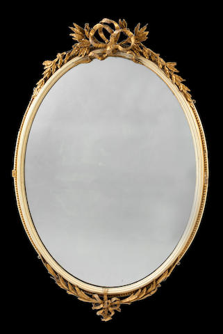 A pair of late 19th century cream painted, parcel gilt and composition mirrors in the Louis XVI style