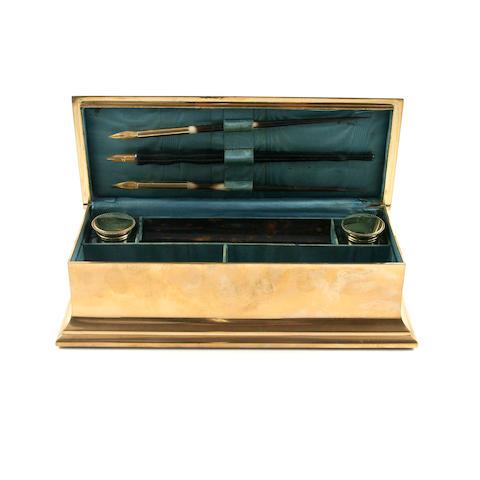 A polished brass writing box