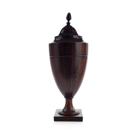 A George III mahogany inlaid spoon urn, together with a part canteen the urn unsigned, the silver various makers and dates