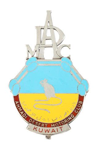 A unique silver and enamel 'Ahmadi Desert Motoring Club - Kuwait' car badge, 1960,