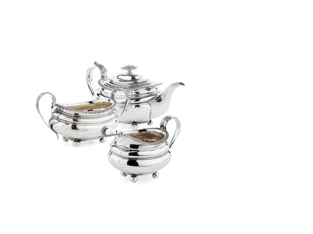 A William IV three piece silver composite tea service the teapot by R.Pearce & G.Burrows, London 1813/25/30