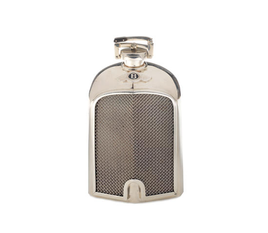 A fine sterling silver '1929 Le Mans Bentley' radiator hip-flask, by Bentley, 1997,