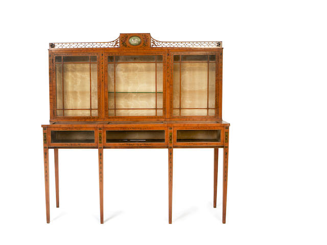 A late Victorian satinwood and polychrome decorated combined bijouterie/display cabinet in the Sheraton revival style