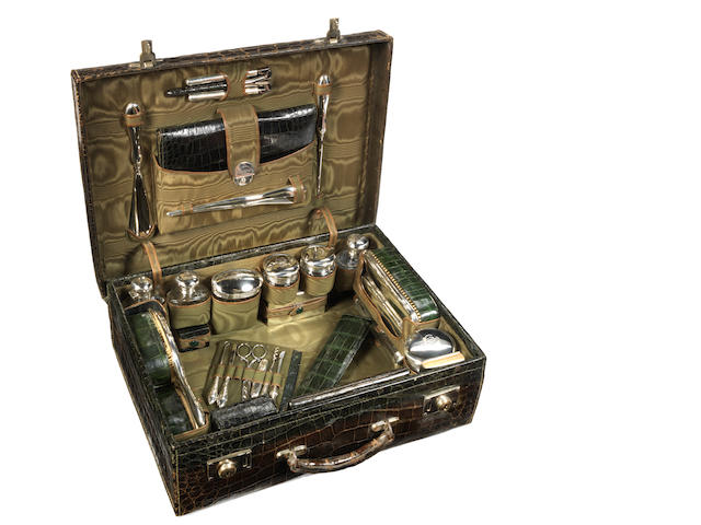 A fine crocodile skin vanity case with sterling silver accessories, by Drew & Sons of Piccadilly, London, 1904,