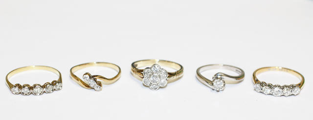 A collection of five diamond set rings, (5)