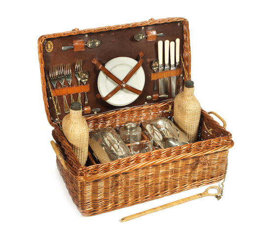 A Veteran wicker-cased Coracle picnic set for four persons,