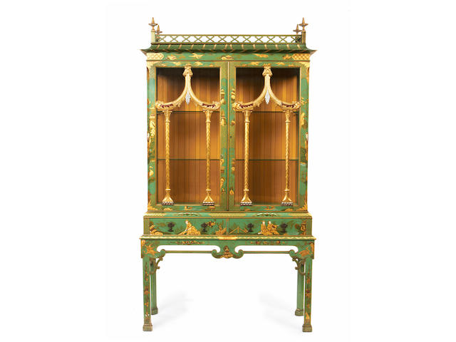 An early 20th century green japanned and gilt decorated display cabinet on stand, in the manner of Hille & Co.