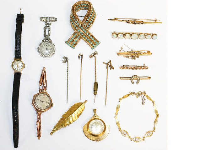 A quantity of brooches, watches and assorted jewellery,