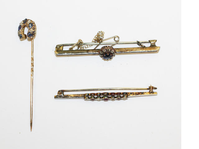 Sapphire and diamond cluster bar brooch, ruby and diamond seven stone stick pin, sapphire and rose diamond horse shoe stick pin (3)