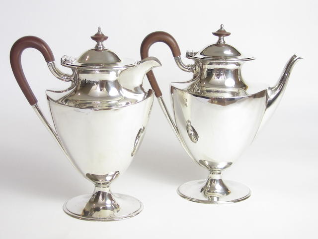 A matched coffee pot and hot water pot by Elkington & Co Ltd, Birmingham 1913 and 1924