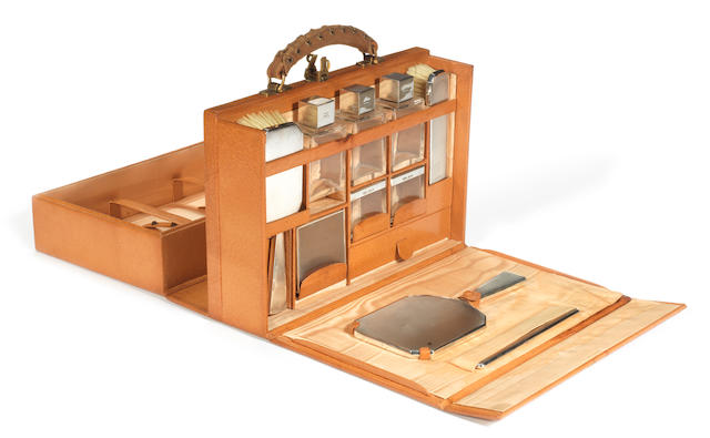 A fine leather cased vanity set with sterling silver accessories, by Asprey of Bond St, 1939,