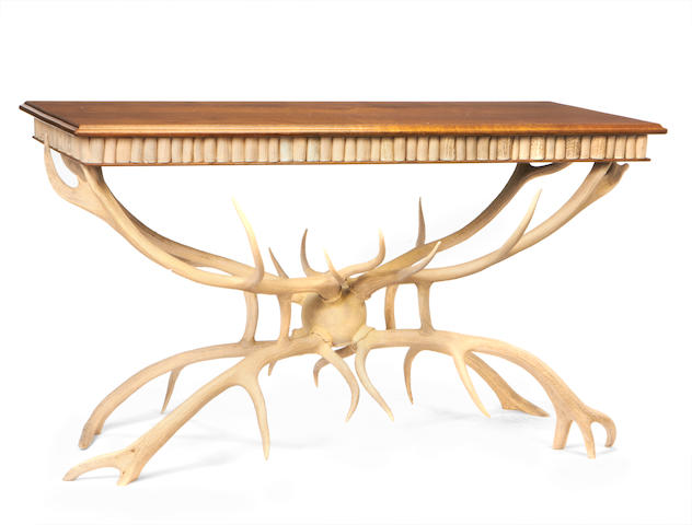A bleached antler and oak centre table