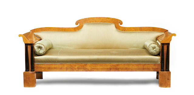 A 19th century Biedermeier satinbirch and ebonised sofa