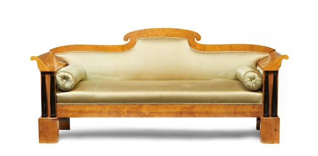 A 19th century Biedermeier satinbirch and ebonised sofa