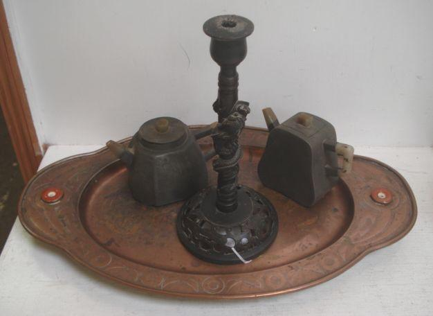 A Chinese bronze candlestick, the column entwined with a dragon, 25cm, and other Chinese metalware, to include a shaped oval copper tray set with two discs, 46.5cm, two pewter teapots with calligraphic inscriptions and other items.