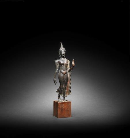 A bronze Figure of a Walking Buddha Thailand, Sukothai style, 15th/16th Century