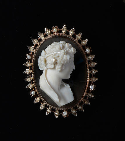 A hardstone cameo and seed pearl brooch