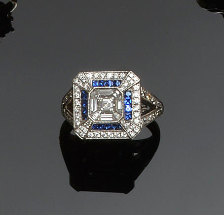 A diamond and sapphire square panel ring