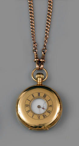 An 18ct gold half hunter pocket watch and an Albert chain