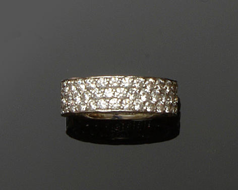 A platinum and diamond half hoop ring