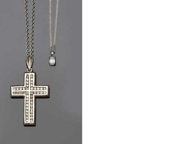 A diamond cross pendant and a diamond single stone pendant (2)