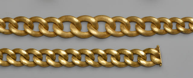 An 18ct gold curb-link necklace and bracelet suite (2)