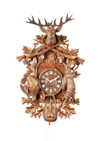 A large and impressive early 20th century carved Bavarian cuckoo clock Anonymous