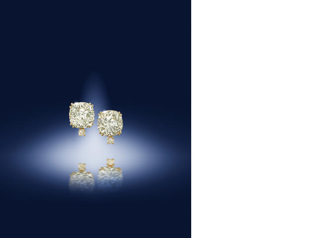 A pair of diamond earclips, by David Morris