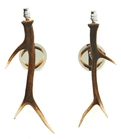 A pair of antler and nickel plated single wall lights