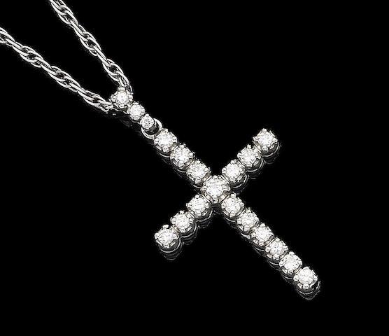 A diamond cross pendant necklace