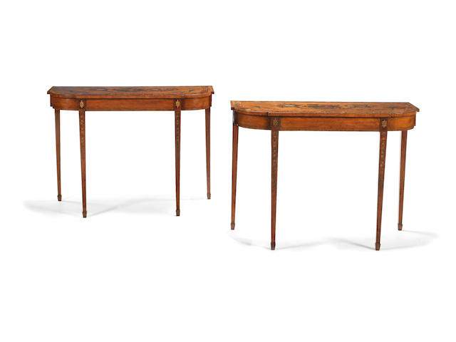 A pair of George III satinwood, tulipwood banded and painted demi-lune pier tables in the manner of Seddon, Son & Shackleton