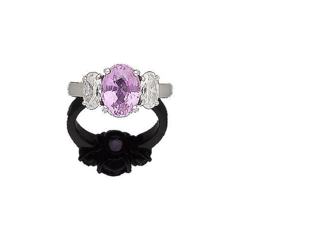 A pink sapphire and diamond three-stone ring