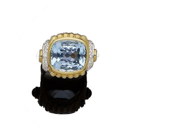 A blue topaz, ruby and diamond dress ring