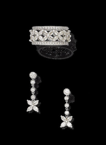 A diamond ring and pendent earring suite, by Tiffany & Co. (2)