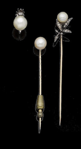 Two natural pearl stickpins and a natural pearl earring (3)