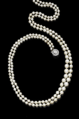 A double-strand pearl necklace with diamond clasp