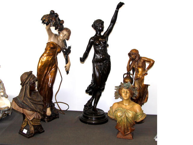 A spelter figure of a lady, two terracotta figures and two busts