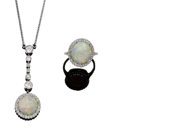 An early 20th century opal and diamond pendant necklace and ring suite (2)