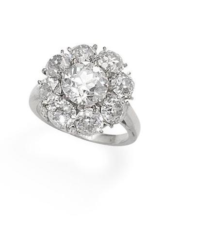 A diamond cluster ring, by Ventrella