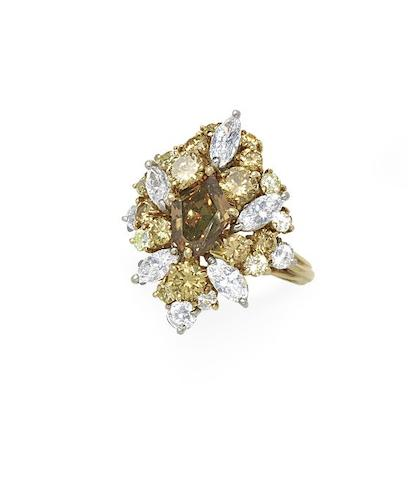 A fancy-coloured diamond and diamond cluster ring