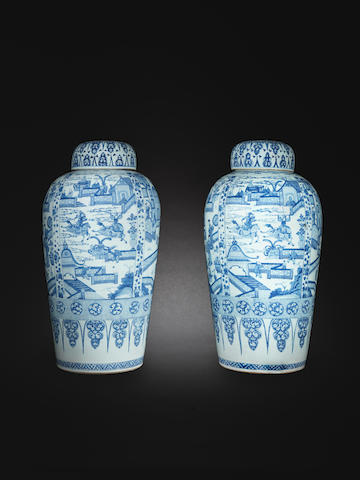 A rare pair of massive blue and white 'soldier' vases and covers Kangxi
