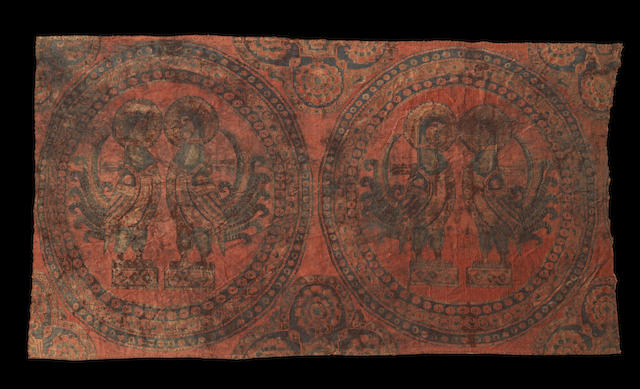 A fine woven silk Textile Fragment depicting paired cockerels Sogdiana, Central Asia, circa 8th Century