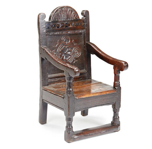 A Charles I oak and inlaid child's chair, probably originally a high-chair, circa 1630