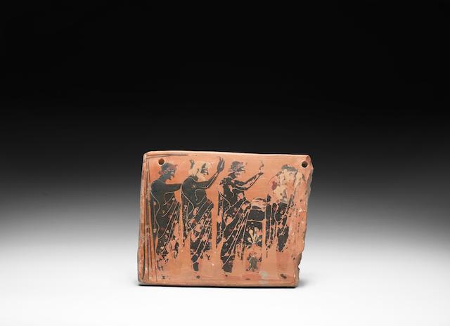 An Attic black-figure terracotta funerary plaque