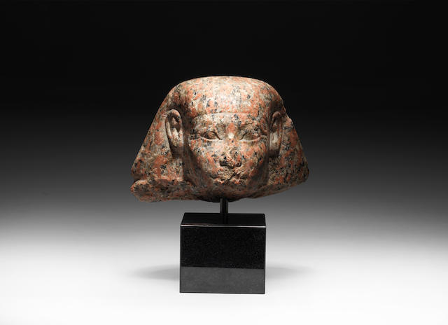 An Egyptian rose granite male head