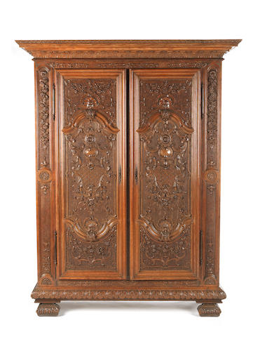 A French 19th century oak armoire in the Regence style