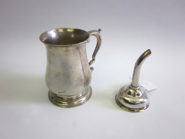 A George III silver mug maker's mark mistruck W.?, London 1766; together with an unmarked wine funnel  (2)